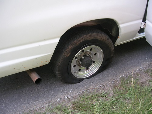 """Getting help with a flat tire from a man and his son"" (http://goo.gl/1W9V5H) by benuski (http://goo.gl/LNX19b) is licensed under CC BY 4.0 (http://creativecommons.org/licenses/by/4.0/)"